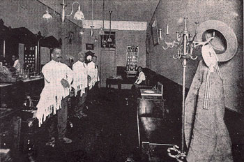 The interior of Henry Wade Robbins' Ann Arbor barber shop at 117 Ann St.