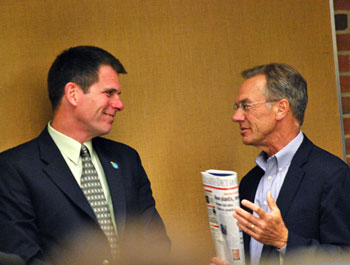 City administrator Steve Powers (left) chats with University of Michigan community relations director Jim Kosteva before the meeting. Kosteva was not attending the meeting in connection with the rail project, but to receive an award on behalf of the university from the city's historic district commission for the university's Burton Tower.