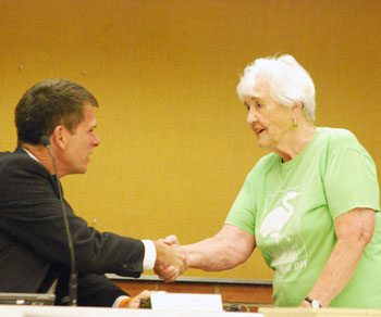 Eunice Burns, former city councilmember and DDA board member, introduces herself to city administrator Steve Powers before the council meeting started. Burns was on hand to receive a proclamation for Huron River Day, which falls on July 15 this year. Burns, along with Shirley Axon, is cofounder of the event.