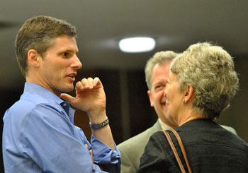 Carsten Hohnke (Ward 5) chats with Stephen Kunselman (Ward 3) and Ann Arbor art commission chair Marsha Chamberlin after the vote.