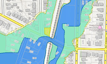 Knights market is the parcel highlighted in yellow. The flood plain is the green shaded area. The floodway is the blue shaded area.