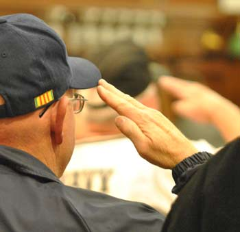 Veterans attending the Sept. 19, 2012 county board meeting saluted during the Pledge of Allegiance.