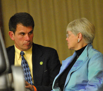 City administrator Steve Powers and Marcia Higgins (Ward 4) during a recess in the meeting.