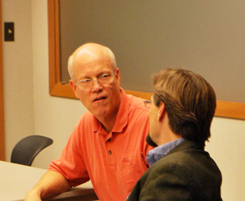 From left: Ypsilanti mayor Paul Schreiber and AATA board chair Charles Griffith chat before the meeting started.