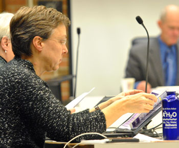 "Margie Teall peruses a map showing forecasted congestion on Ann Arbor roads under a ""do nothing"" scenario. Transportation program manager Eli Cooper had distributed the map to councilmembers."