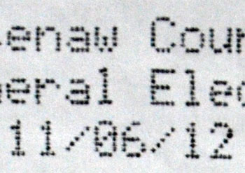 From the header of the dot-matrix-printed results tape from a voting machine.