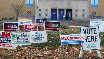 Campaign signs outside the polling location at Eberwhite Elementary School in Ann Arbor.