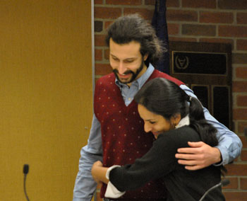 Before the meeting, Sumi Kailasapathy gets a hug of support from Washtenaw County commissioner Yousef Rabhi.