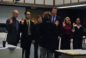 The newly elected members of council are sworn in by city clerk Jackie Beaudry (back to camera). From left: mayor John Hieftje, Chuck Warpehoski (Ward 5), Margie Teall (Ward 4), Christopher Taylor (Ward 3), Sally Petersen (Ward 2) and Sumi Kailasapathy (Ward 1).
