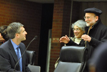 Residents Eleanor Linn and Marc Gerstein chat with Christopher Taylor before the meeting.
