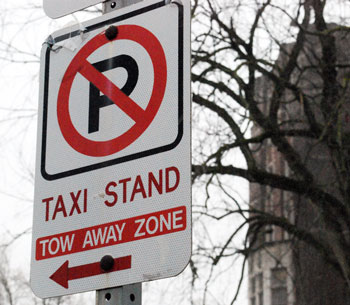 Taxi stand sign on State Street in front of the Michigan Union.