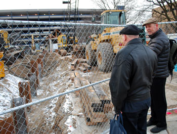 Before the Feb. 21, 2013 meeting of the AATA board, Terry Black (manager of maintenance) and Eli Cooper (AATA board member) inspect the construction site of the new Blake Transit Center on Fifth Avenue in downtown Ann Arbor.