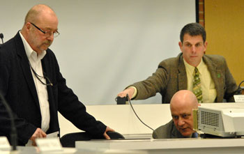 From left: 15th District Court administrator Keith Zeisloft, city administrator Steve Powers, judge Joe Burke