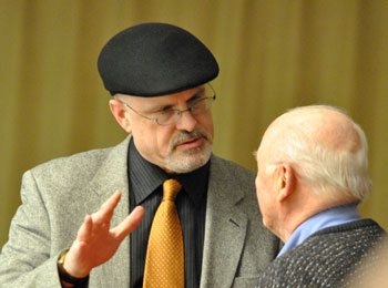 Architect Brad Moore (left) talks with resident Ray Detter. Moore is architect for two projects that were on the council's March 4 agenda – Blue Heron Pond and 624 Church St. The councils approval of both site plans indicates the council is not contemplating imposing a Moore-atorium on site plans.