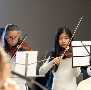 Tappan Middle School orchestra students performed for the board.