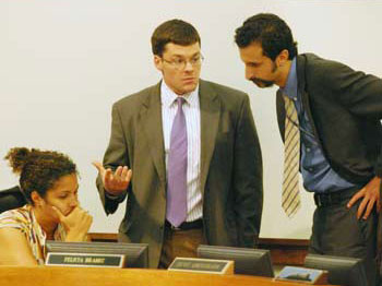 The leadership of the Washtenaw County board of commissioners, from left: Felicia Brabec (D-District 4 of Pittsfield Township), Andy LaBarre (D-District 7 of Ann Arbor), and Yousef Rabhi (D-District 8 of Ann Arbor). Rabhi is board chair. Brabec serves as chair of the board's ways & means committee, and LaBarre chairs the board's working sessions.