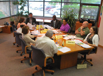 The AAATA board's special meeting was held at the headquarters building at 2700 S. Industrial Highway. Clockwise starting at the head of the table: Charles Griffith, Michael Ford, Susan Baskett, Eli Cooper, Gillian Ream, Eric Mahler, Sue Gott, Roger Kerson, and Anya Dale.