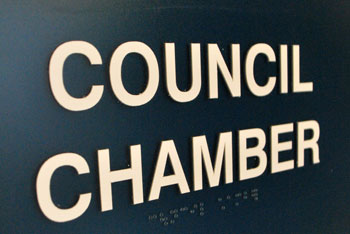 The sign on the door to the Ann Arbor city council chamber, installed in the summer of 2013, includes Braille.