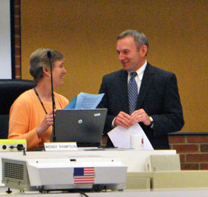 Attorny Mark Merlanti talked with city of Ann Arbor planning manager Wendy Rampson before the meeting started.