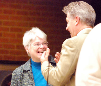Marcia Higgins (Ward 4) and Stephen Kunselman (Ward 3) share a light moment before the meeting started. They had both contested Democratic primaries two days earlier. Kunselman prevailed in a narrow race. Jack Eaton won the Ward 4 race.