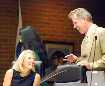 Sally Petersen (Ward 2) and Stephen Kunselman (Ward 3) share a laugh before the meeting started.