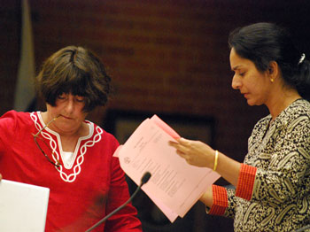 From left: Jane Lumm (Ward 2) and Sumi Kailasapathy (Ward 1) discuss the pink sheets on which nominations and appointments to city boards and commissions are printed.