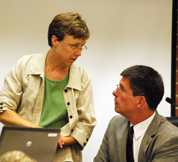 Margie Teall (Ward 4) talked with city administrator Steve Powers before the meeting started.