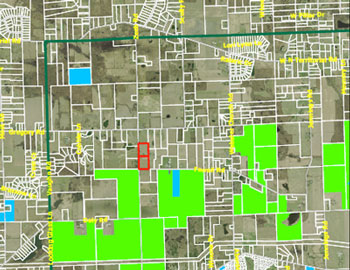 The Sheldon and Wolf property is indicated in red. The green highlighted area denotes area already protected as a part of Ann Arbor's greenbelt program. The heavy green line is the boundary encompassing eligible properties. This is the northwest corner of the boundary area.