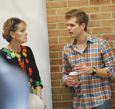 Resident Kathy Griswold talks with Michigan state representative Adam Zemke (D-55)