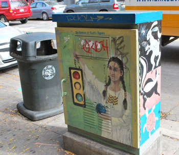 """Goddess of Traffic"" signed by Sophie Gillet on the reverse. The traffic signal control box is located near the northwest corner of the intersection of State and Liberty streets in downtown Ann Arbor."