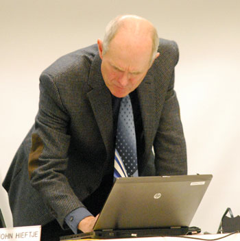 Mayor John Hieftje checked his computer screen before the meeting started. Six hours later, the meeting adjourned.