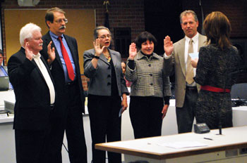 Swearing in of the councilmembers who won election on Nov. 5, 2013. From left to right: Mike Anglin (Ward 5), Jack Eaton (Ward 4), Sabra Briere (Ward 1), Jane Lumm (Ward 2) and Stephen Kunselman (Ward 3). Administering the oath was city clerk Jackie Beaudry.