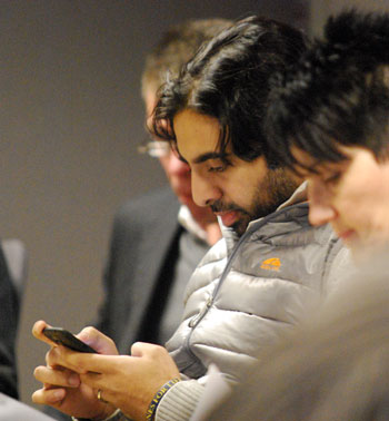 Rishi Narayan checked his smartphone before the meeting started.