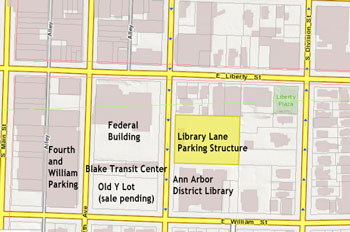 "The Library Lane parking deck is highlighted in yellow. The name ""Library Lane"" is based only on the proximity of the structure to the downtown location of the Ann Arbor District Library. The library does not own the structure or the mid-block cut-through. (Base image from Washtenaw County and City of Ann Arbor GIS services.)"