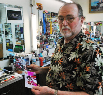 At his downtown barbershop, shortly after getting the news that the court had ruled in his favor, Bob Dascola showed The Chronicle photos of himself as a clown participating in Ann Arbor s Fourth of July parade – something he has done for several years. He will be participating again this year – also as a clown, not as a city council candidate, because he's already registered his parade entry that way.
