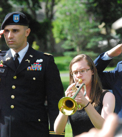Lorna Barron, who plays trumpet in the Huron High School band, performed Taps.