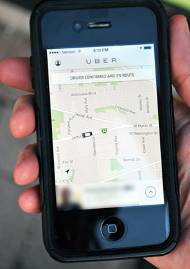 Screen of iPhone showing Uber vehicle responding to request for a pickup on May 24. The resulting trip – from Jackson & Maple to Liberty & Main was calculated by Uber as $8. With the current introductory promotion it cost nothing.
