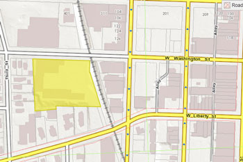 The city-owed 415 W. Washington parcel is highlighted in yellow.