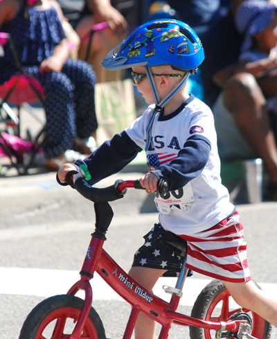 Cute kid on bike.
