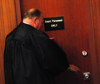 Judge Donald Shelton exited the courtroom on his final motion day, Aug. 27, 2014.