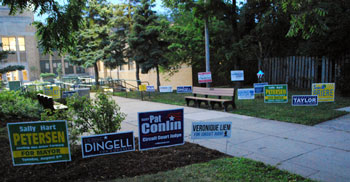 At 6:30 a.m. the  lawn outside the Slauson Middle School polls was bristling with campaign yard signs just outside the 100-foot limit.