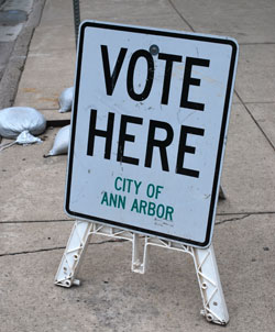 """Vote Here"" sign designating an Ann Arbor polling location for a previous election."